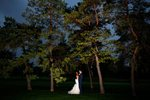 bride & groom on golf course under the tree